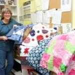 Food-2-Go coordinator Jenny Lidington with a warm donation from Project Linus